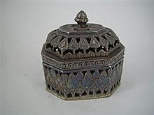 AN ASIAN SILVER POT POURRI CASKET, rectangular, with canted corners, pierced and chased. Width 6cm.
