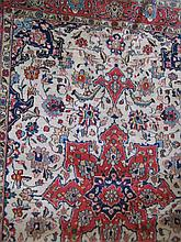 A CENTRAL PERSIAN WOOL RUG with a central medallion on an ivory field. 194 x 142cm.