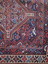 A SOUTH PERSIAN NIRIZ WOOL RUG with two rows each of three linked diamond medallions within multiple geometric borders. 216 x 170cm.