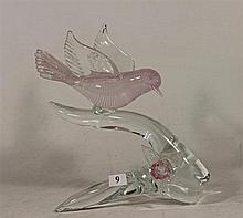 AN ART GLASS SCULPTURE OF BIRD ON A BRANCH, clear and pink glass. Height 25.5cm.