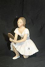 A DAHL JENSEN PORCELAIN FIGURINE OF A GIRL HOLDING A MIRROR. Height 18.5cm.