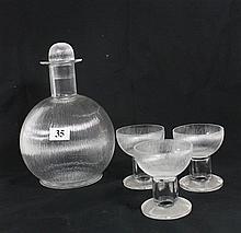 A LALIQUE LIQUEUR SET, decanter and six glasses.