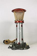 A VINTAGE LIGHTHOUSE LAMP. Height 32cm.