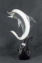 A MURANO ART GLASS DOLPHIN SCULPTURE, on black base. Height 39cm.