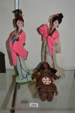 TWO CHINESE DOLLS, together with an American Indian doll. (3)