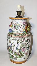 A CHINESE REPUBLIC PERIOD EXPORT WARE VASE, famille rose peacock design, ht 35.5cm.
