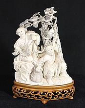 A CHINESE IVORY CARVING 'Fishermen with Catch', signed; on hardwood stand. Figure height 14cm.