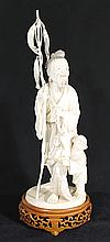A CHINESE IVORY CARVING 'Sage and Attendant Boy with Fish', signed; on hardwood stand. Height 30cm.