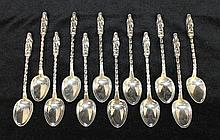TWELVE CHINESE SILVER TEASPOONS, with Quanyin finials. lt 13cm.
