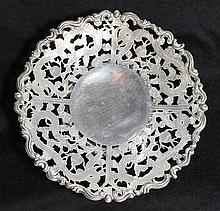 A CHINESE YECHING SILVER BON BON DISH, rim pierced with Dragons chasing pearls. dia 19.5cm