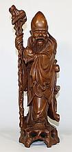 A CHINESE CARVED WOODEN FIGURE OF AN IMMORTAL. ht 47cm.