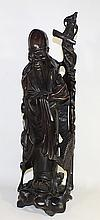 A CHINESE CARVED WOODEN SAGE, holding a staff and Peach, with inlaid eyes and teeth