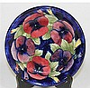 A MOORCROFT  DISH, pansy pattern. dia 22cm.