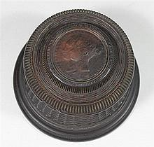 A CARVED TOBACCO TAMPER, Victoria and Albert medallion to lid. ht 10cm.