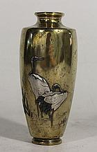 A JAPANESE BRONZE VASE, inlaid with silver and shakado Red-Crowned Cranes. ht 14.5cm.