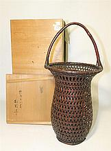 A JAPANESE WOVEN CANE IKEBANA VASE, signed, ht 45cm.
