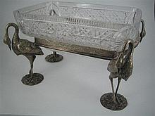 A CRYSTAL AND SILVER-PLATE SERVING DISH, the rectangular dish in a silver-plate frame with flamingo figure supports. Length 26.5cm.