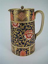 A SPODE 'IMARI' CHINA JUG with silver-plate pivot-action cover. Height 15cm.