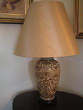A CHINA TABLE LAMP with gilt leaf-scrolls; with shade.