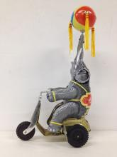 Japanese tin litho Elephant on Moped
