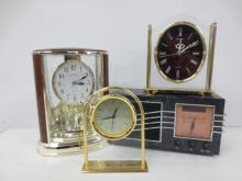 Three mantle clocks and  clock radio