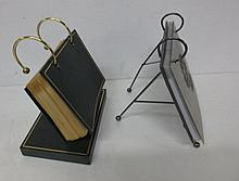 Two photo albums on display stands