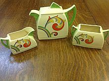 A Royal Doulton deco three piece Syren pattern tea set, with teapot & cover