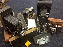 A collection of cameras - some leather cased, a folding automatic brownie n