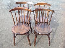 A set of four Ibex spindle-back kitchen chairs, with circular seats raised