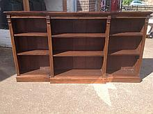 A large Edwardian mahogany breakfront library bookcase, having moulded corn