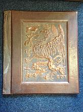 A large nineteenth century rectangular leather folio, the front recessed pa