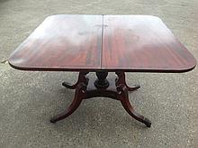 A regency mahogany turn-over-top tea table, the rounded crossbanded flaps a