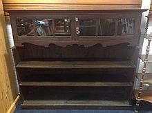 An arts and crafts oak bookcase in the manner of Wylie & Lochhead, having m