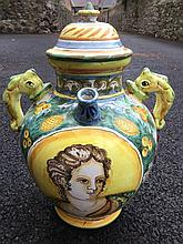 A large Italian majolica wine vessel, the cover with pointed finial on an o