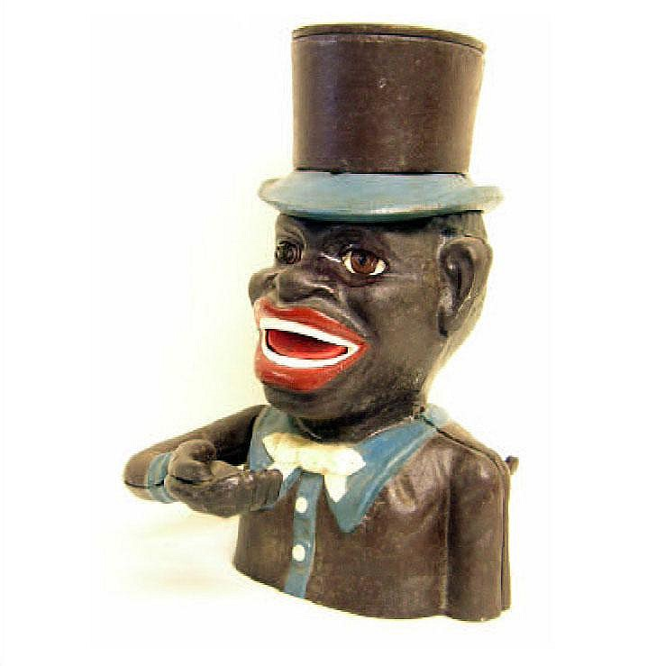 A cast iron 'Jolly Nigger' savings bank/money box.
