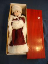 porcelain doll in red and white outfit
