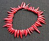 A Chinese Strand of Coral Beads .