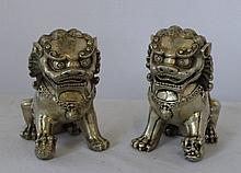 A Pair of Chinese Silvered Metal Temple Dogs