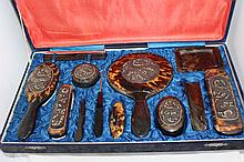 A Chinese Tortoiseshell Boxed Dressing Table Set, Qing Dynasty