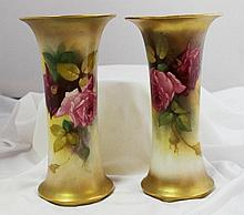 A Graduated Pair of Royal Worcester Vases