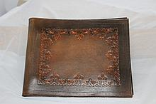 A Hand Tooled Leather Folio
