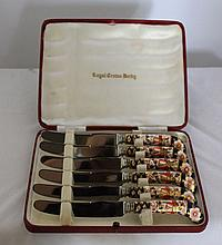 A Boxed Set of Royal Crown Derby Butter Knives ,