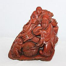 A Chinese Carved Soapstone Figure Group modelled