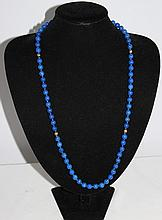 A Lapis Lazuli and Yellow Gold Necklace Marked 14
