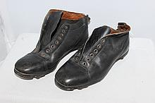 A Pair of Early Leather Football Boots , modelled