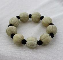 A Chinese White Hardstone Beaded Bracelet