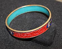 A Chinese Cinnebar and Enamel Bangle