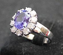 A Tanzinite and Diamond Set Ring