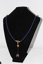 A Strand of Lapis Court Beads