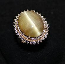 A Chinese Yellow Gold Gem set Ring